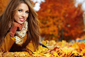 Portrait of very beautiful young woman in autumn park — Stok fotoğraf