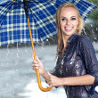 Woman in rain on street - Foto de Stock