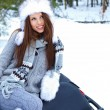 Winter woman on snow background — Stock Photo #12048524