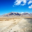 Yellowish mountain road view in tibet - Stock Photo