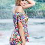 Young sexy girl walking along wet street in rain — Stock Photo