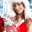Portrait of beautiful sexy girl wearing santa claus clothes — Stock Photo #12121832