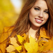 Royalty-Free Stock Photo: Young brunette woman portrait in autumn color