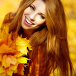 Young brunette woman portrait in autumn color — Stok Fotoğraf #12212841