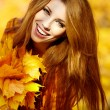 Foto Stock: Young brunette woman portrait in autumn color