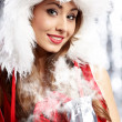 Portrait of beautiful sexy girl wearing santa claus clothes — Stock Photo #12225939