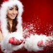 Photo of fashion Christmas girl blowing snow. — Stock Photo #12225983