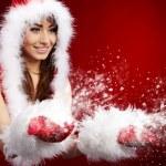 Photo of fashion Christmas girl blowing snow. — Stock Photo #12225983