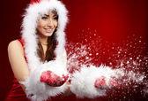 Photo of fashion Christmas girl blowing snow. — Stock Photo