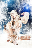 Christmas woman as a snow queen in ice room — Stock Photo