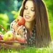Apple woman. Very beautiful ethnic model eating red apple in the — Stock Photo #12292198