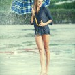 Girl with umbrella. Photo in old color image style. — Photo