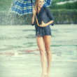 Stock Photo: Girl with umbrella. Photo in old color image style.