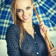 Girl with umbrella. Photo in old color image style. — Stockfoto