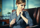 Business woman in an office environment with large stained-glass — Stock Photo
