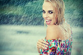 Portrait of young beautiful woman in rain — Stock Photo