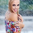 Stock Photo: Portrait of young beautiful woman in rain