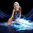 Stock Photo: Saxy woman dancing in water on black ,