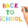 Hand writing with a pencil - Back to school — Stock Photo