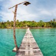 Stock Photo: Old wooden pier in the sea