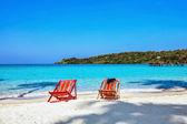 Sun beach chairs at the beach — Stock Photo