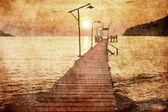 Sunset over the sea in grunge style — Stock Photo