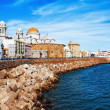 Embankment along the sea and the old Spanish town — Stock Photo