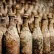 Old wine bottles covered with dust in retro style — Foto Stock
