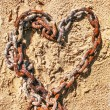 Chain in the shape of a heart on the sand — Stock Photo #12139118