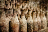 Old wine bottles covered with dust in retro style — Stock Photo