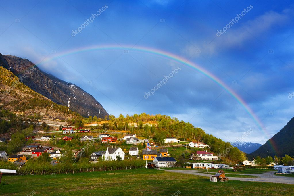 Rainbow and beautiful Norway town — Stock Photo #12190004