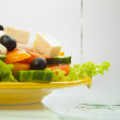 Greek Salad with oil flowing — Stock Photo