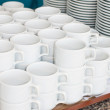 Catering. saucers, and cups of tea. — Stock Photo #11663444