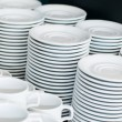Catering. saucers, and cups of tea. - Stock Photo