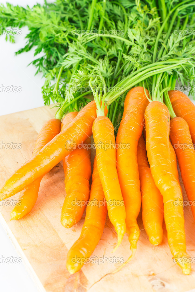 Fresh carrots with green tops  Stock Photo #11663364