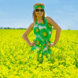 Beautiful woman on rape field — Stock Photo