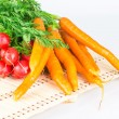 Fresh carrots and radishes with tops — Stock Photo