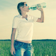 Young woman with a bottle of water — Stock Photo
