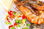 Giant prawns with sea bass fish. — 图库照片
