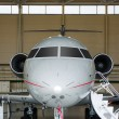 Private Jet in hangar — Stock Photo