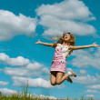 Young woman close-up jumping - Stock Photo