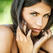 Beautiful woman with bare shoulders sad looking at camera — Stockfoto