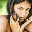 Beautiful woman with bare shoulders sad looking at camera — Stock Photo