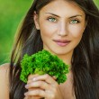 Woman with bare shoulders holding bunch of parsley — Stock Photo #10739906
