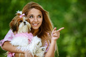Beautiful smiling young woman with small dog — Stock Photo