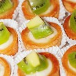 Tasty little tarts with kiwi fruit - Stock Photo