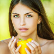 Woman with bare shoulders holding yellow pepper — Stock Photo #10784521