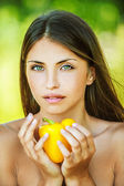 Woman with bare shoulders holding yellow pepper — Stock Photo