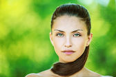 Portrait of young beautiful woman with bare shoulders — Stock Photo