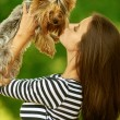 Woman with Yorkshire Terrier — Stock Photo #11372100
